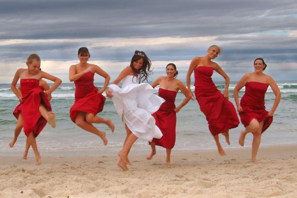 Sophisticated red bridesmaid dresses for beach weddings
